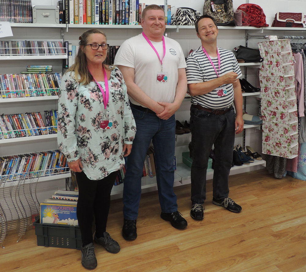 John with his team in a Mencap charity shop