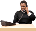 Woman sat at desk using a telephone