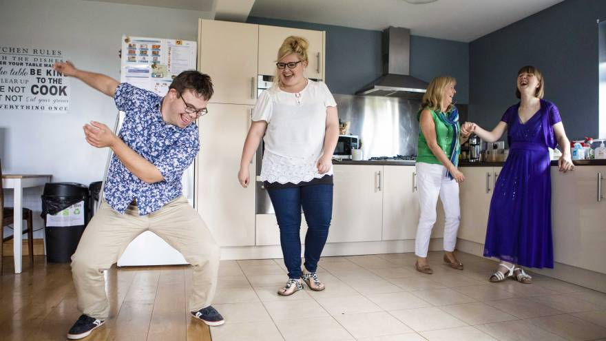 Group of people dancing in a kitchen