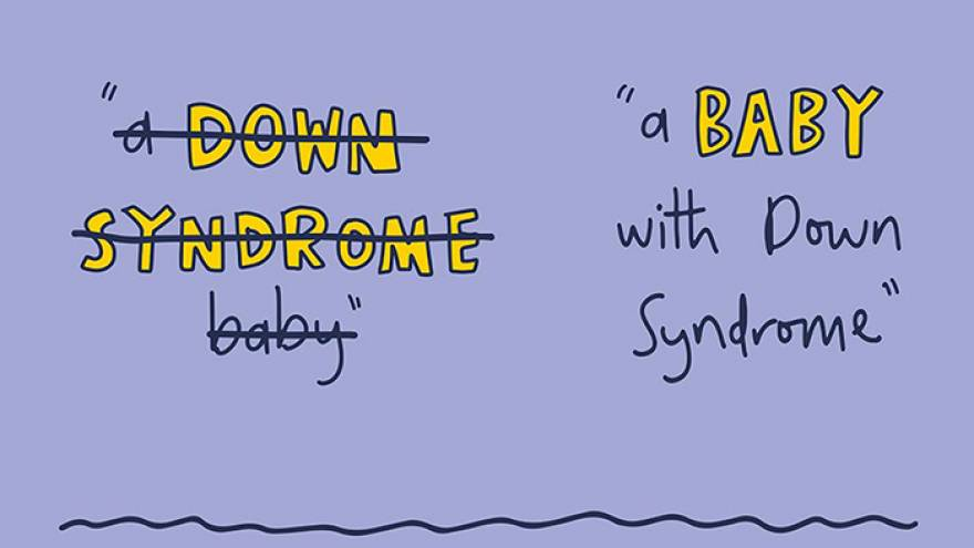 "Writing with text ""A Down Syndrome baby"" crossed out, with the text ""a baby with Down Syndrome"" visible next to it."