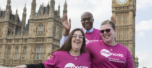 Group of people stood wearing Mencap t-shirts in front of Houses of Parliament and Big Ben
