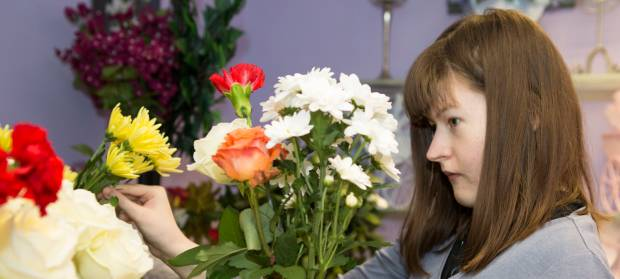 Woman arranging flowers in a flower shop.