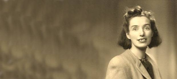 Old sepia image of woman, Judy Fryd, sat posing for the camera